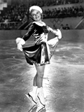Sonja Henie on a Santa Attire while Skating and Swaying