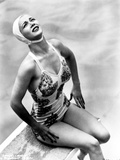 Carole Landis on a Swimsuit sitting on a Dive Board