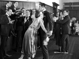 Colleen Moore Leaning on Chest of a Man with Crowd
