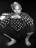 Yul Brynner Posed in polka dot With Black background