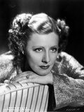 Irene Dunne on Dress sitting and Leaning Portrait