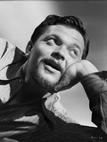 Orson Welles Leaning Head on Hand in Stripes Polo