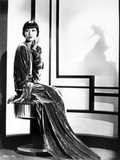 Anna Wong sitting on the Chair  wearing a Long Gown
