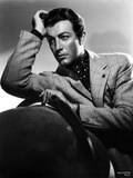 Robert Taylor posed in Suit with Head Leaning on Hand