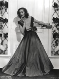 Loretta Young posed at the Door with Long Satin Gown