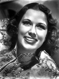 Eleanor Powell on an Embroidered Top and smiling