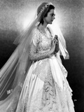 Heather Angel in an Embroidered Bridal Gown with Veil
