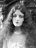 Mary Astro Portrait wearing Necklace and Curly Long Hair