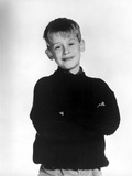 Macauley Culkin Posed in Black With White Background
