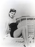 Debra Paget sitting on a Bench wearing Black Lingerie