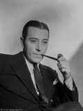 George Raft wearing Black Coat and Tie with Tobacco Pipe