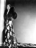 Alice Brady standing wearing a Dress with Fur Scarf