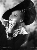 Madeleine Carroll Looking Up in Black Dress with Big Hat