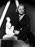 Talullah Bankhead wearing a Black Dress with Statue