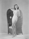Susan Hayward Leaning on Handcrafted Chair in Two Piece