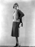 Fay Wray standing in Two Piece Dress in Black Pumps