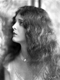 Mary Astro on a Necklace and Curly Long Hair Portrait