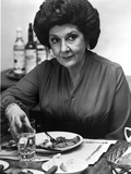 Maureen Stapleton Eating on a Table wearing Black Blouse