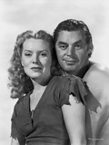 Johnny Weissmuller standing Behind a Woman in a Portrait