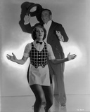 Al Jolson posed with a Woman in Front wearing a Suit