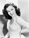 Susan Hayward wearing a White Dress and Hands on Waist