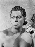 Johnny Weissmuller Holding a Knife in Black and White
