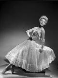 Vera Ellen on Printed Dress sitting and Leaning Portrait