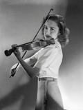 Olivia DeHavilland Playing Violin in Black and White