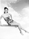 Esther Williams on Swimsuit Posed on Diving Board