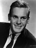 Tab Hunter Posed in Black Suit With White Background