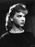 Anne Francis wearing Black Dress with Pearl Necklace
