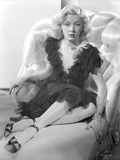 Gloria Grahame Posed on Couch wearing Black Dress