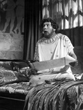 Peter Ustinov Feeling Shocked in White Dress With Paper