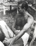 Sean Connery sitting on Chair  wearing White Underwear