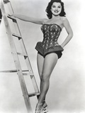 Debra Paget standing Beside a Ladder in Black and White
