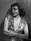 Claudette Colbert Posed in Glossy Dress with Arm's Cross