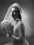 Portrait of Arlene Dahl posed in Wedding Gown