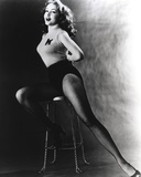 Julie Newmar Siting on Chair in Lingerie Black and White