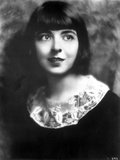 Colleen Moore on a Dark Top and smiling Portrait