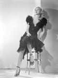 Gloria Grahame Posed Siting on Chair in Black Gown