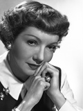 Claudette Colbert Posed in Black Dress with White Collar