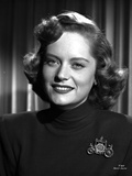 Alexis Smith smiling in Portrait wearing a Black Shirt