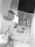 Gloria Grahame Looking in a Mirror in Backless Dress
