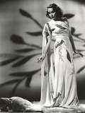 Dolores Del Rio standing in White Floral Dress