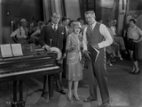 Al Jolson Discussing with His Group Near the Piano