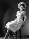 Anne Baxter on Printed Top sitting and smiling