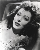 Loretta Young Portrait Lying with Curly Hair