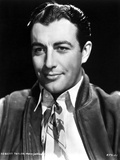 Robert Taylor smiling in White Shirt and Vest