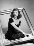 Joan Bennett sitting Pose with a Frame Portrait