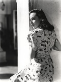 Dolores Del Rio Posed sitting in Printed Dress